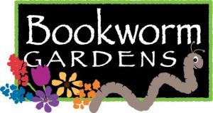 """Illustrated logo of the words """"Bookworm Gardens"""" in white against a black background, surrounded by a green border with multi colored flowers and a worm in the foreground."""